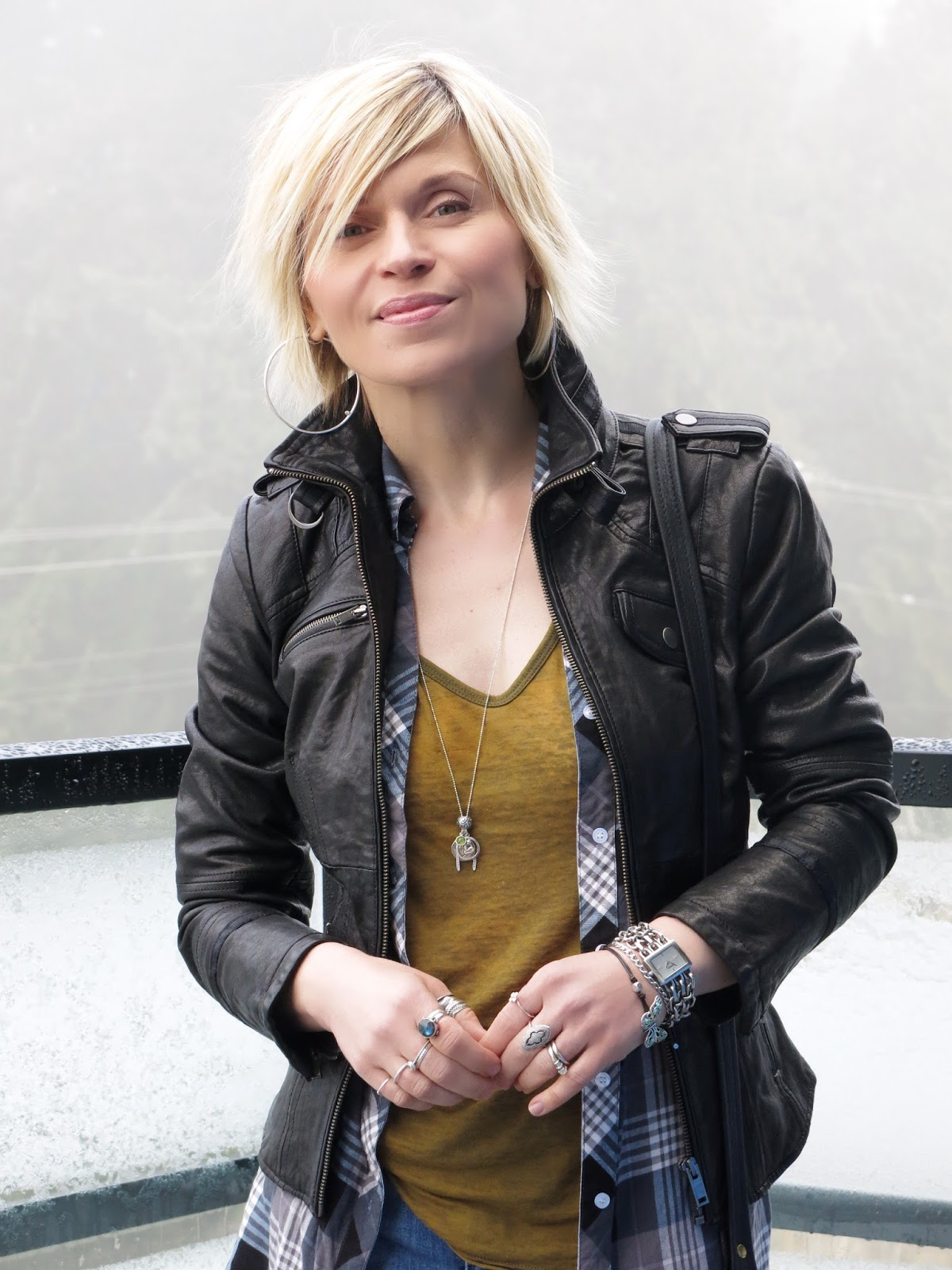 Danier moto jacket with a slouchy tee and plaid shirt