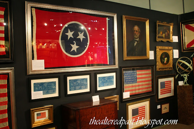 Antiques and Garden Show, framed flags and blueprints