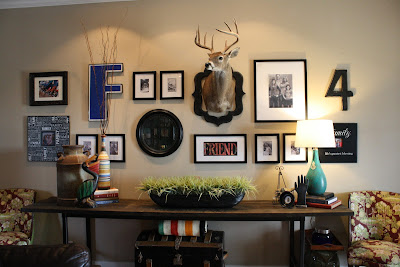 family gallery wall with cow art and long diy console table