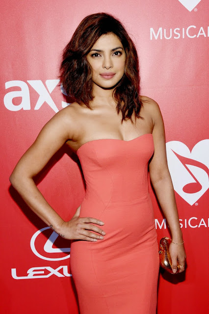 Priyanka Chopra in Orange Gown 2015 MusiCares Person Of The Year Gala Honoring Bob Dylan Los Angeles+2.jpg