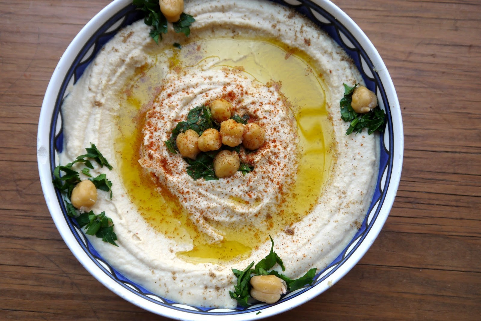 Bint rhodas kitchen how to make really smooth authentic hummus serve drizzled with olive oil and any of the following sprinkled with paprika and cumin and garnished with chickpeas olives pickles or parsley forumfinder Gallery