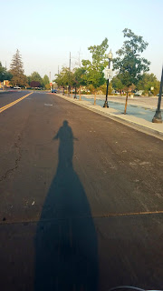 shadow of a cyclist, bicycle commuter, shadow of bicycle commuter
