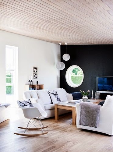 Living room with black accent walls and white sofas
