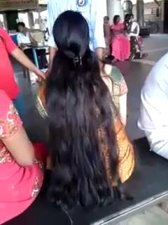 Wet long haired Malayalam girl with center clip.