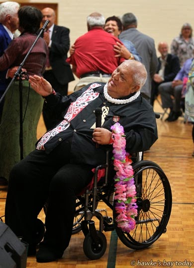 Tommy Taurima conducts the choir as folks waltz at his request, to one of his songs - function at the Church of Jesus Christ of Latter Day Saints, Bridge Pa, Hastings. Tommy was presented with The Lei Pulama Aloha Living Treasure Award for services to the performing arts. photograph