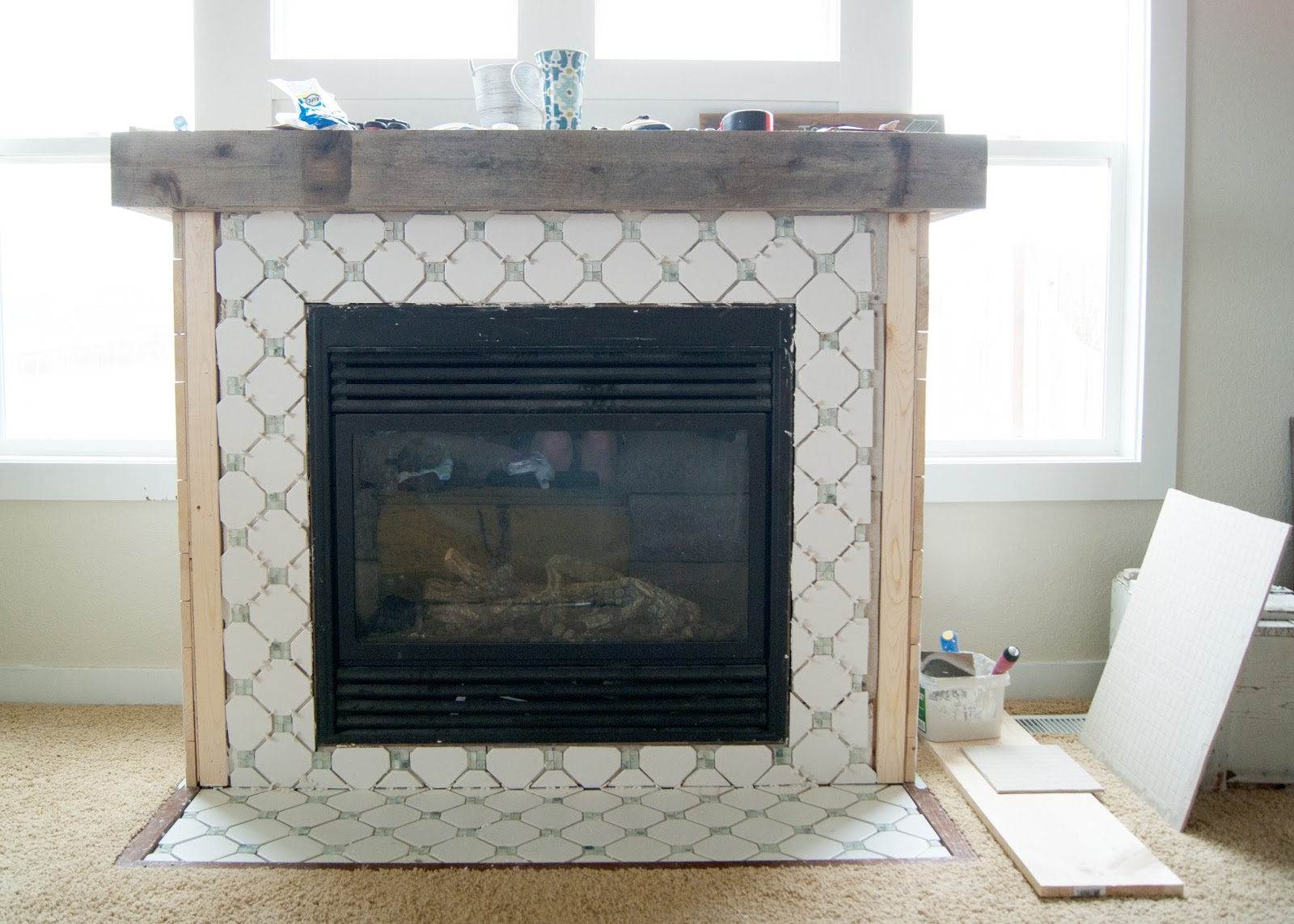 Vintage inspired fireplace makeover using yard sale tile laid in an octagon and dot pattern