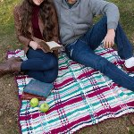 http://www.redheart.com/free-patterns/plaid-picnic-throw