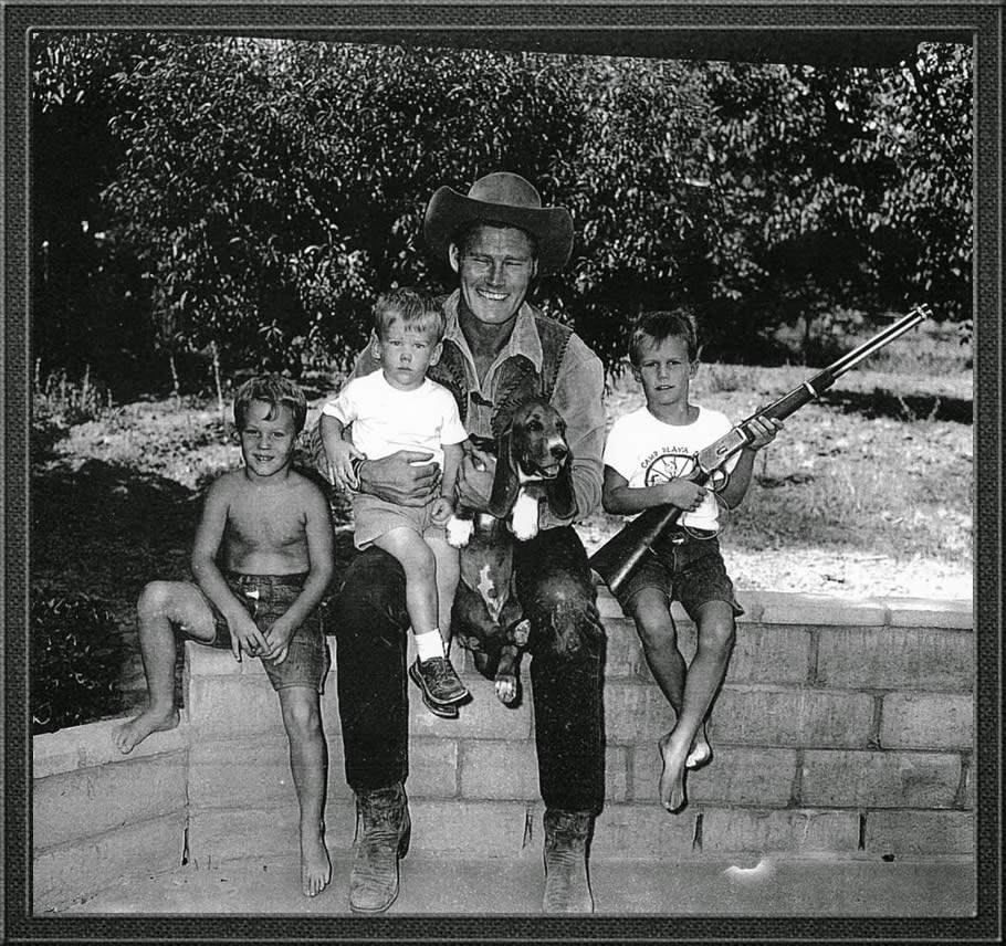 Chuck Connors with his sons and dog at home.