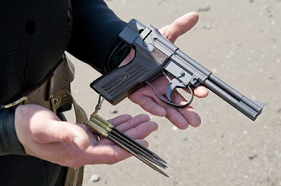 Using gloved palms with trigger guards