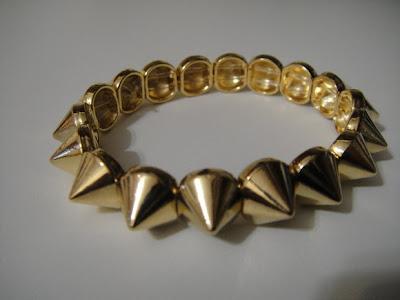 pulseira-spike-dourada.jpg (580×435)