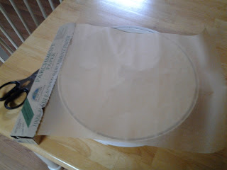 Cover the dehydrator tray with parchment paper.