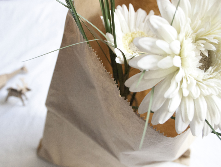 paper bag with white flowers