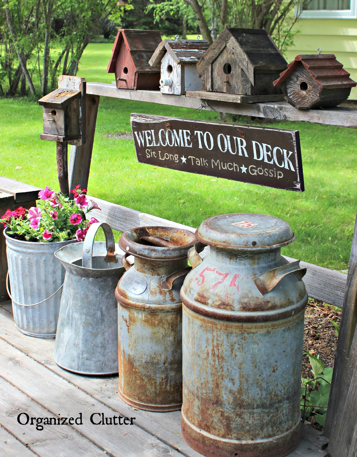 Decorating the deck with rustic birdhouses organized clutter for Rustic outdoor decorating