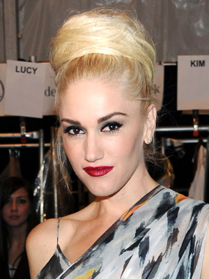 Gwen Stefani's impeccable style spills over to her hairstyles too; her chic updo makes for a fierce and dramatic look.