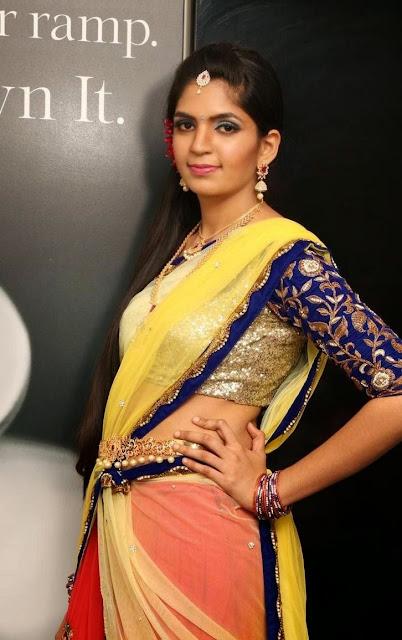 Anusha Cute and Young Beauty Anusha in Yello Red Half Saree and Blue Choli