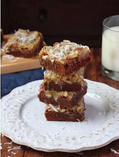 http://www.spoonfulofflavor.com/2013/09/09/coconut-pecan-brownies/