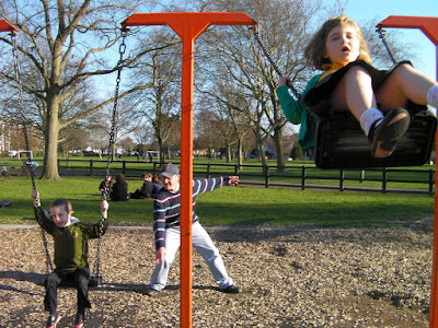 alternating timed swinging spring day in the park