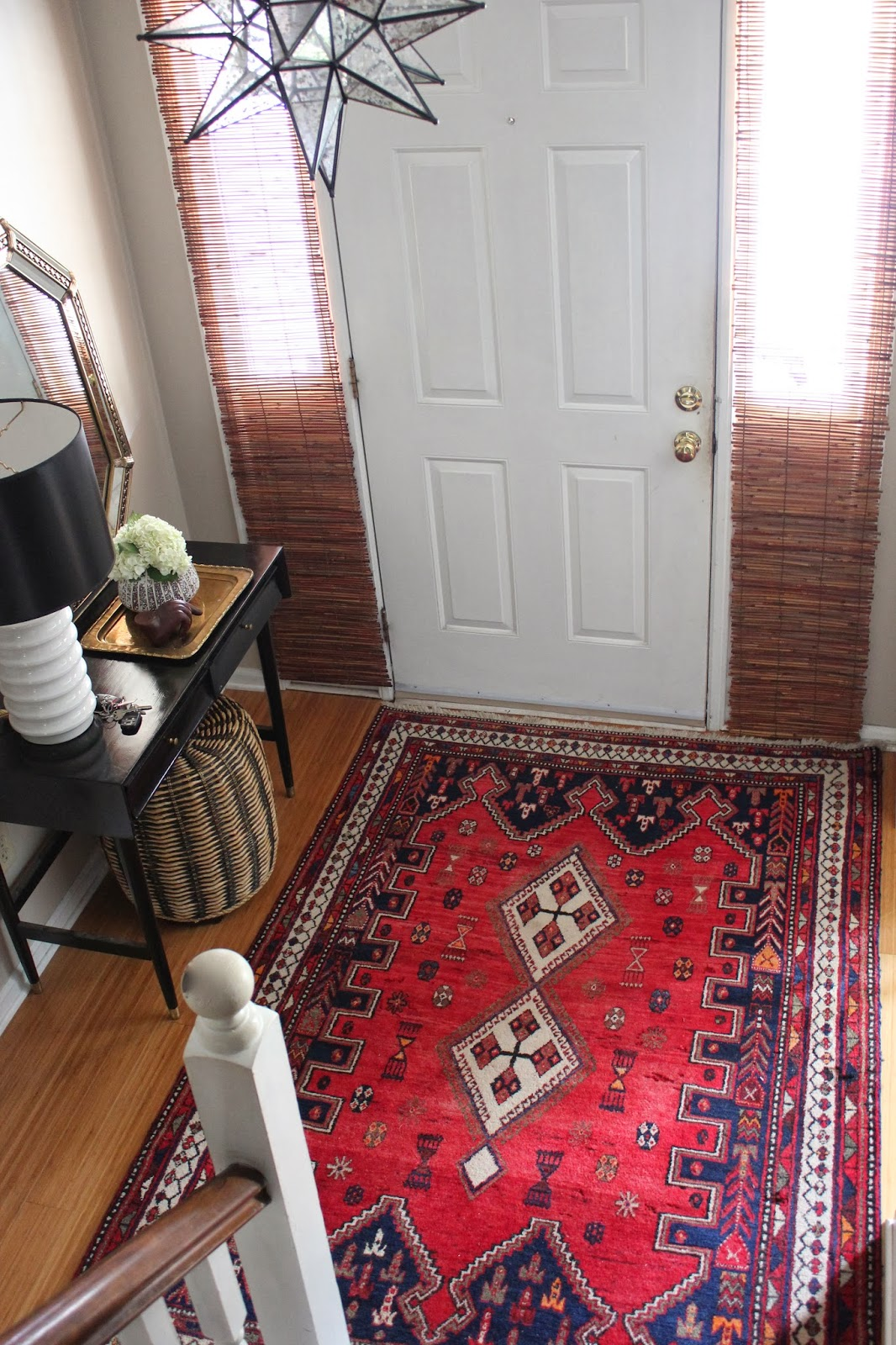 Spicing up my entryway with a persian rug dayka robinson for Foyer rugs decorating