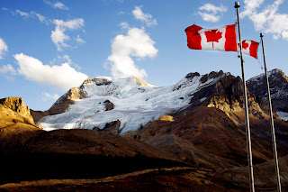 Waving Canadian Flags and Mountain Landscape HD Wallpaper