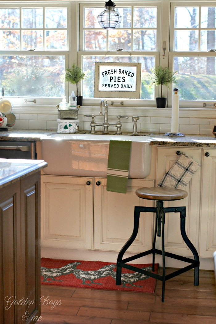 Farm style apron front sink in a farmhouse style kitchen - www.goldenboysandme.com