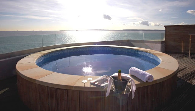The hot tub offers stunning views back to the coast of England