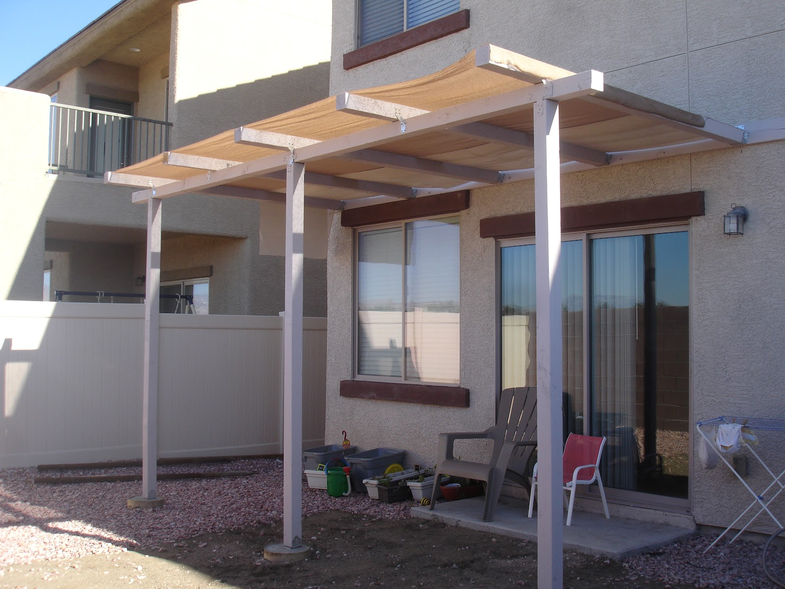 Alex haralson update on our diy patio cover for Build covered patio