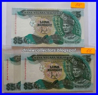 2       Malaysia 6th Series Replacements RM5 NZ0421746                    (light foxing) & NZ0552532 (both without cross on flag post)                     Jaffar Hussein's signature