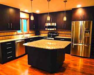 Modern Feng Shui Kitchen With Dark Color Cabinetry.