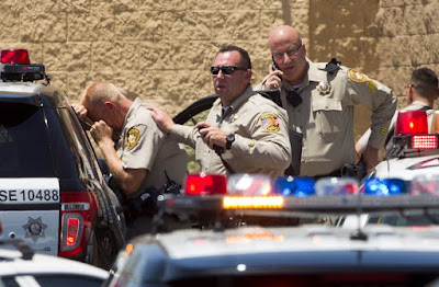 The New York Times depicts police at the scene of a terror incident at a Las Vegas Walmart–the kind of political violence the paper thinks will surprise its readers. (photo: Steve Marcus/Reuters)