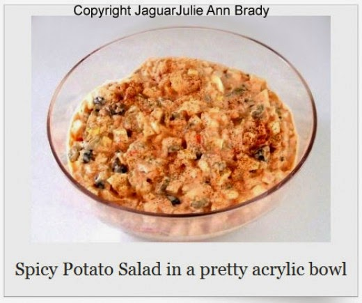 spicy potato salad in pretty acrylic bowl