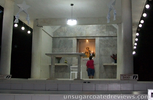 religious woman praying at the altar
