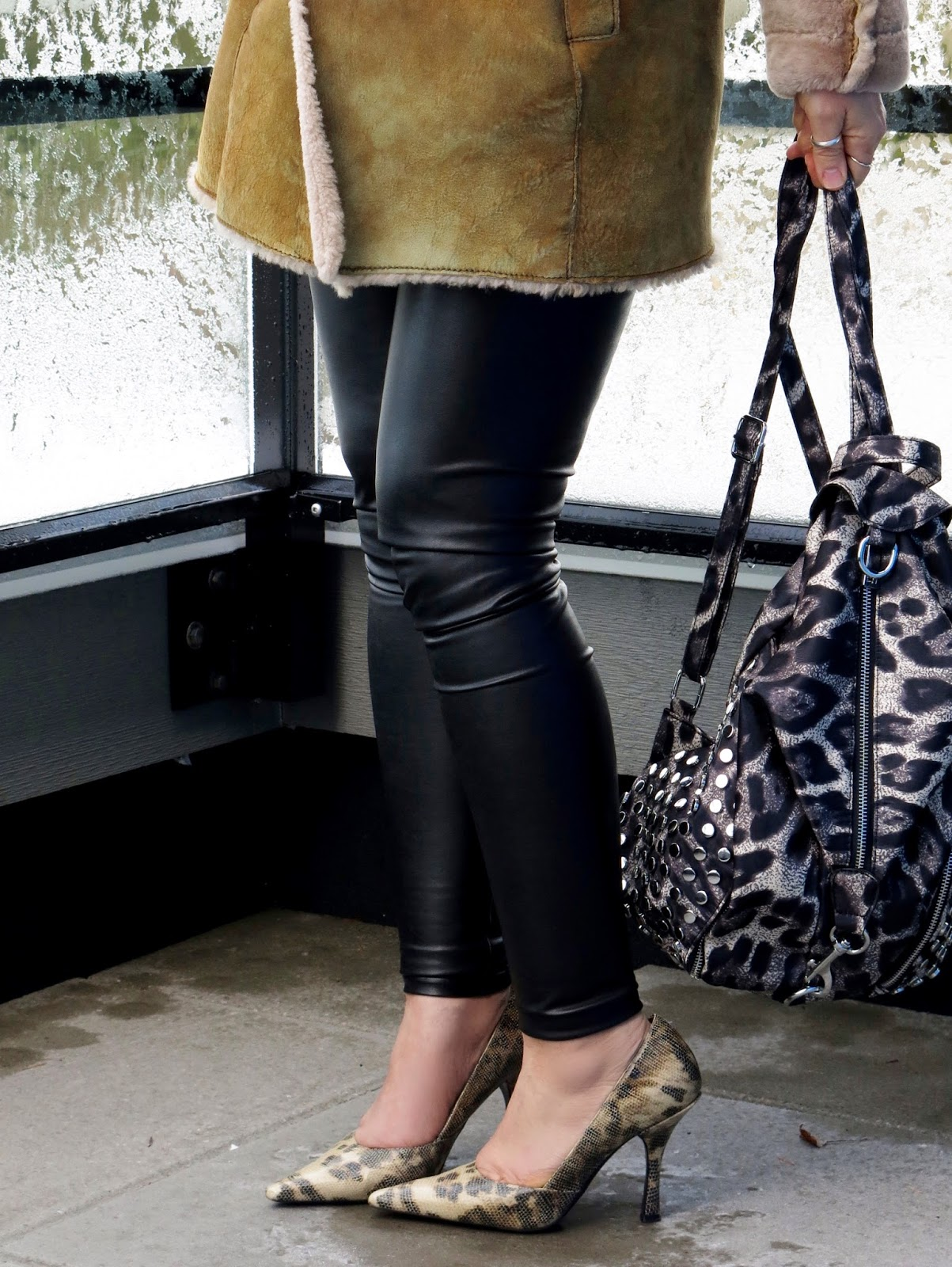 sheepskin coat, faux-leather leggings, reptile pumps, and leopard-print backpack
