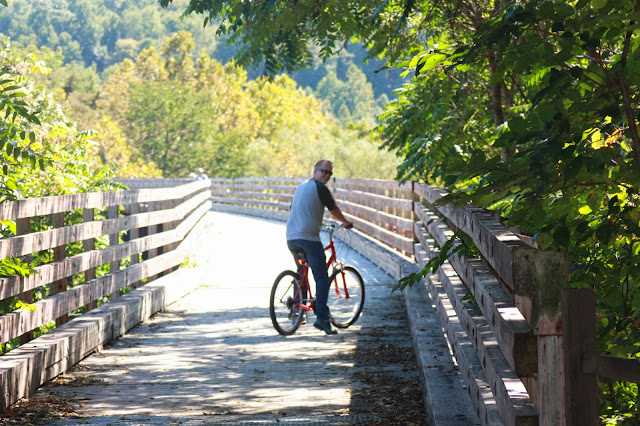Justin riding bike on wooden bridge