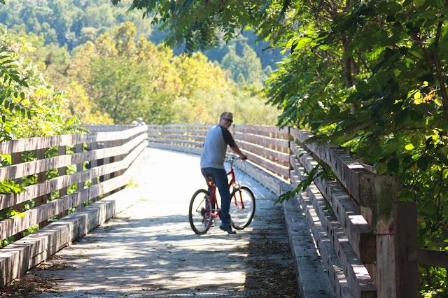 Justin riding bike on wooden bridge