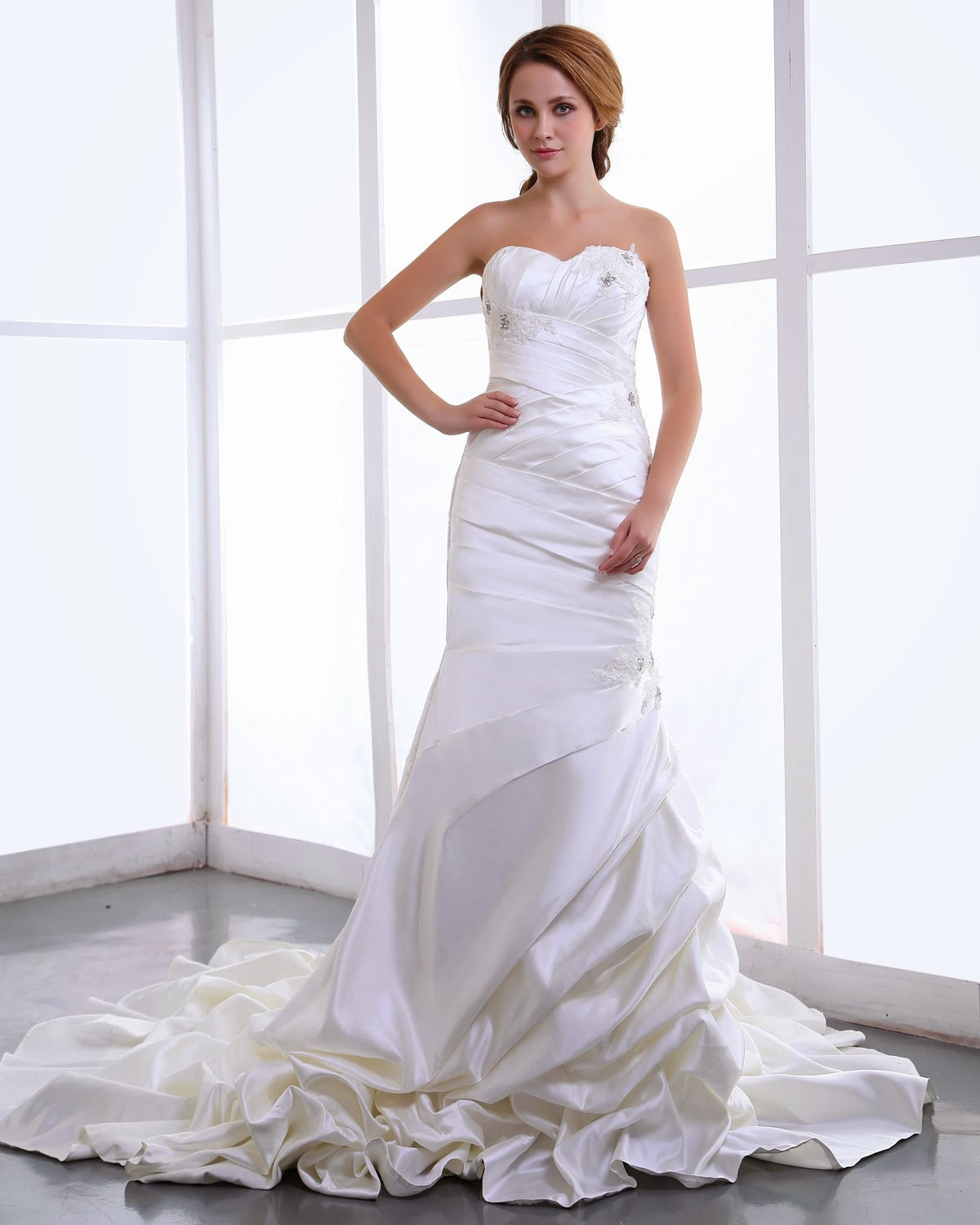 http://www.victoriasdress.co.uk/2014-new-style-trumpet-mermaid-sweetheart-sleeveless-satin-white-wedding-dress-with-ruffles-bukch148.html