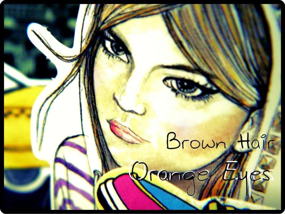 Brown hair orange eyes