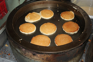 Pan cakes sold at a bus stop