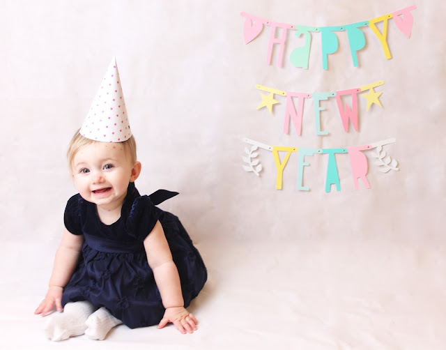 happy new year baby photo baby wearing party dress bunting