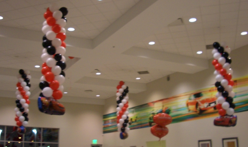 It 39 s a party air filled balloon decorations hanging from for Balloon ceiling decoration