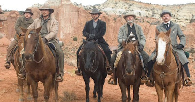 Christian Bale and Russell Crowe on horse back in 3:10 To Yuma (2007)