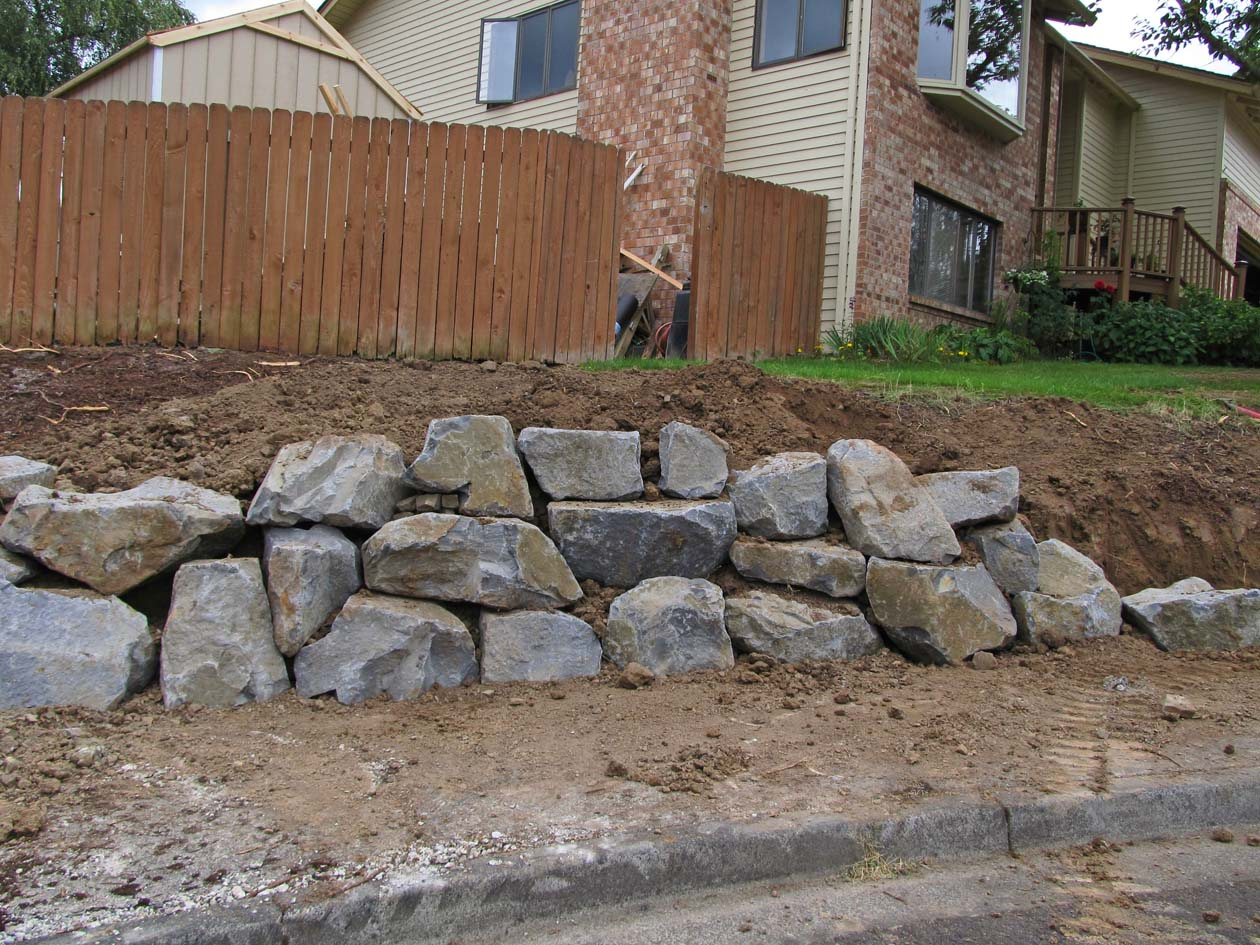 Black Basalt Stone Wall : Top o the mountain retaining walls before and after