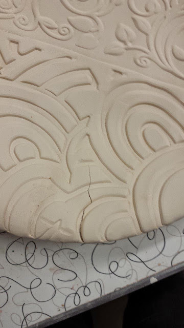 Crack in slab made roller pattern ceramic bowl.