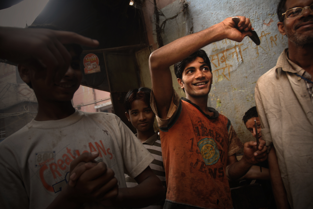 Young guy playing with his meat knife in Delhi in India