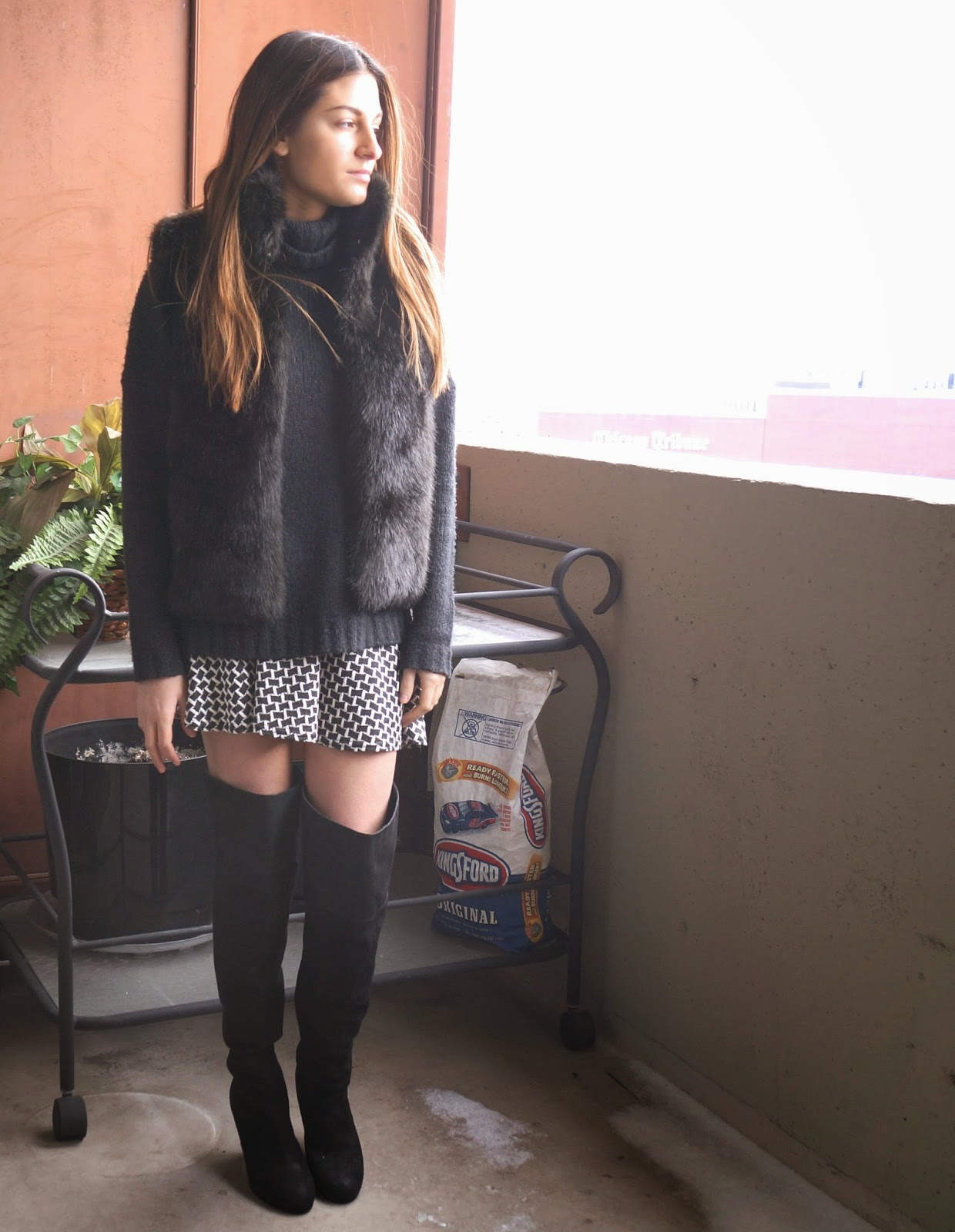 black fur vest, aqua black and white skirt, knee high boots
