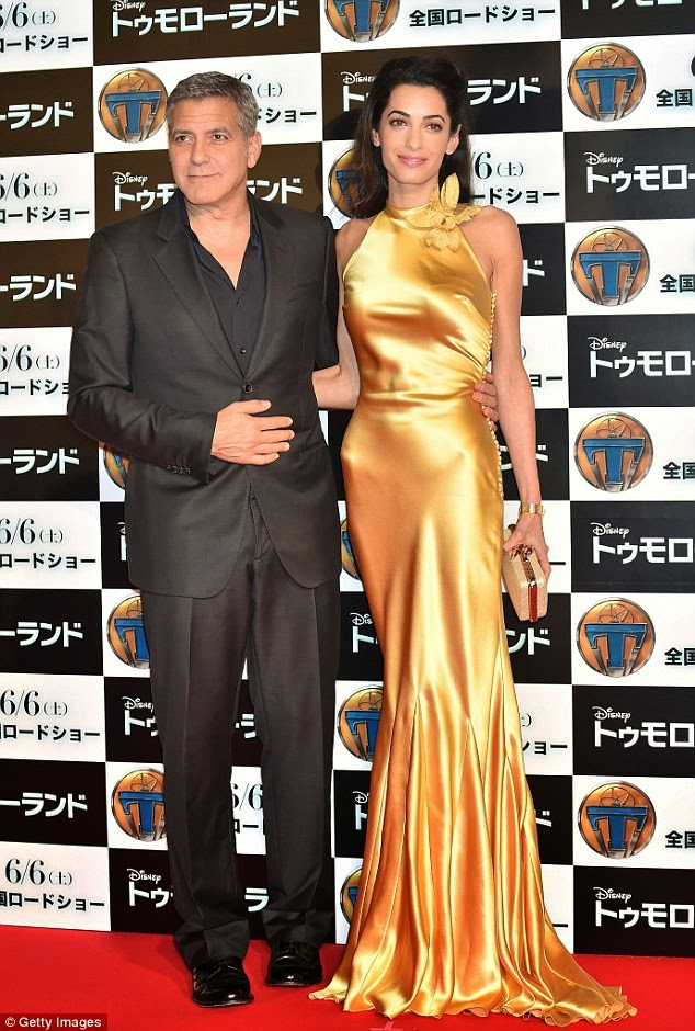 Amal Clooney stuns in satin yellow at the 'Tomorrowland' Tokyo premiere