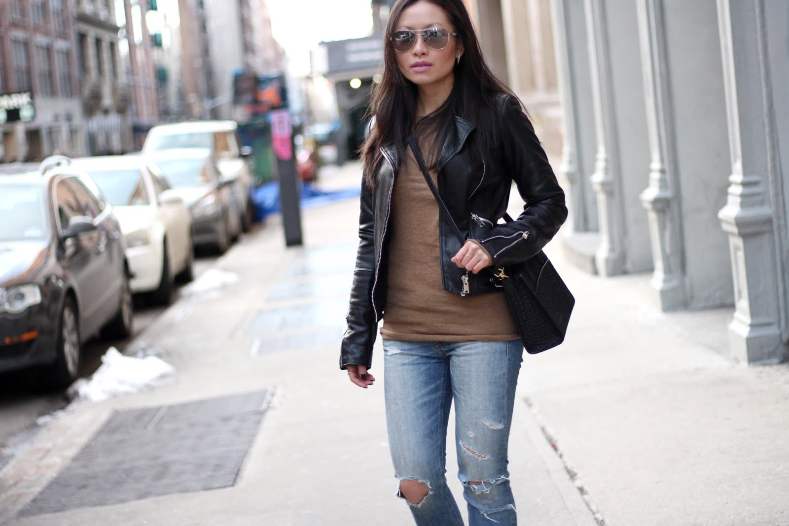 leather jacket IRO black ankle booties camel coat Emily Cho mini tote bag