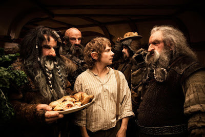 The vagabond dwarves feast unwelcome at Bilbo's hobbit hole, Martin Freeman as Bilbo Baggins, directed by Peter Jackson
