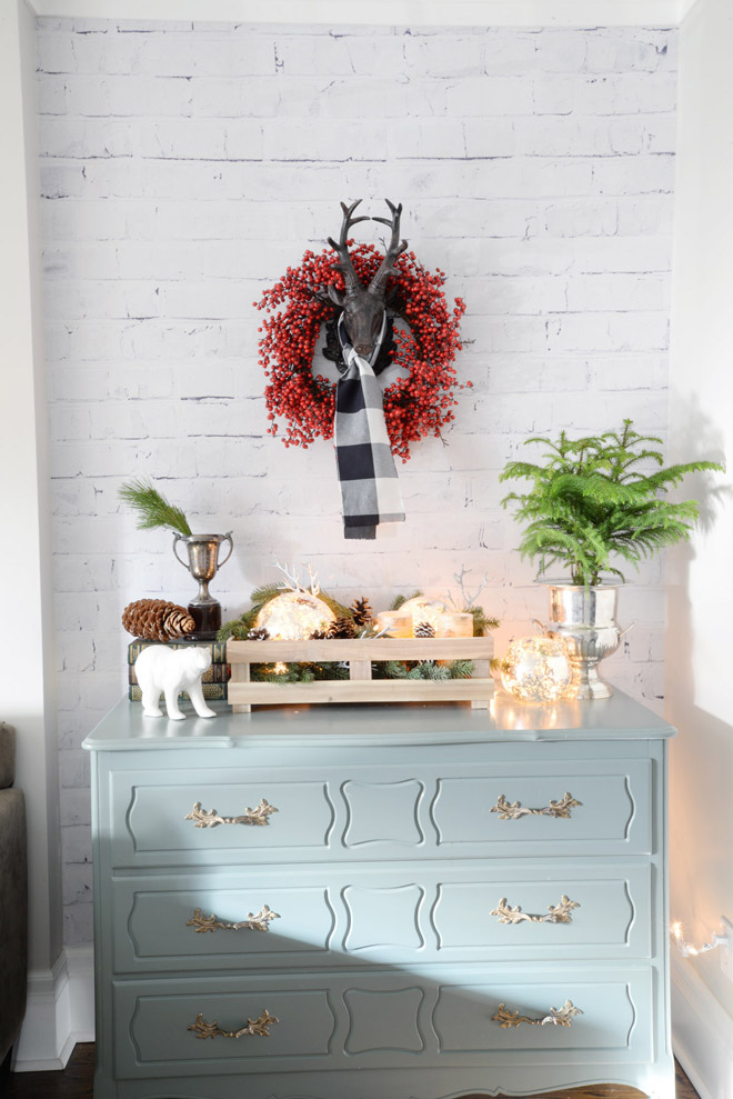 brick wall wallpaper reindeer head berry wreath plaid scarf