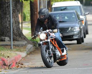 Harley Crashes Into Car