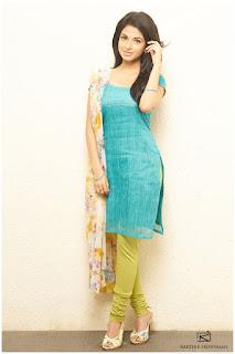 Iswarya Menon dazzling Pics in Kurti Saree and Shorts Spicy Portfolio